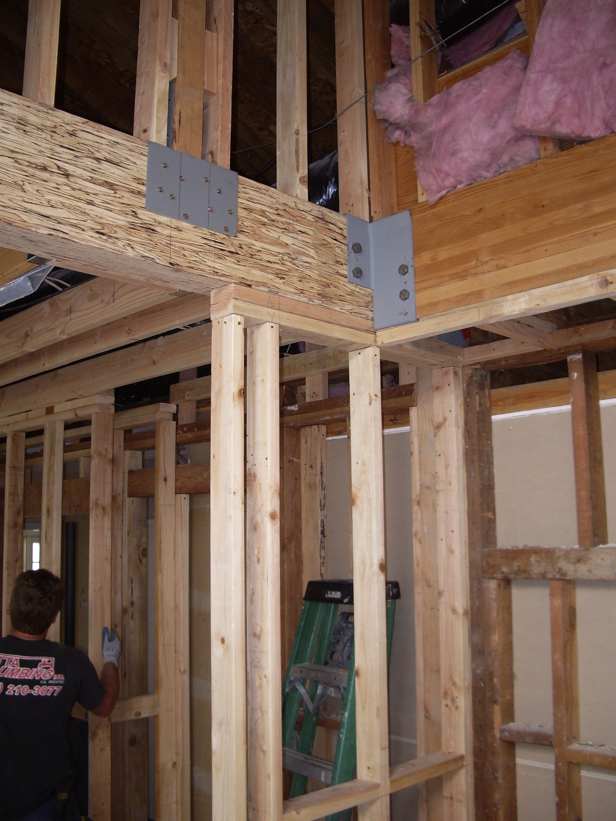 There were several bearing walls removed requiring engineered components.