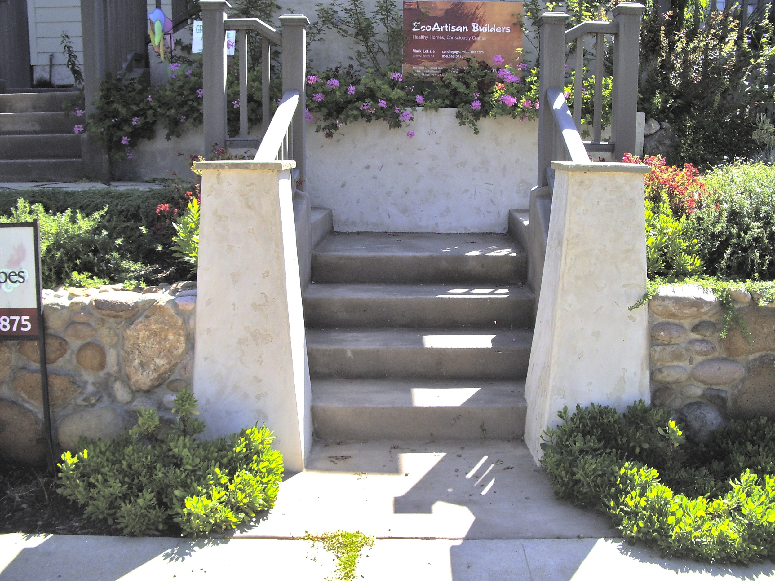 New front steps, walls and landscaping.Note the 70 year old stone wall, patched and re-pointed and ready for another seventy.