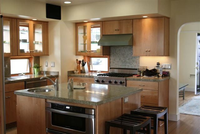 The kitchen as viewed from the dining area. Note the light coming in thru the cupboards and the windows between the counter and cupboards.