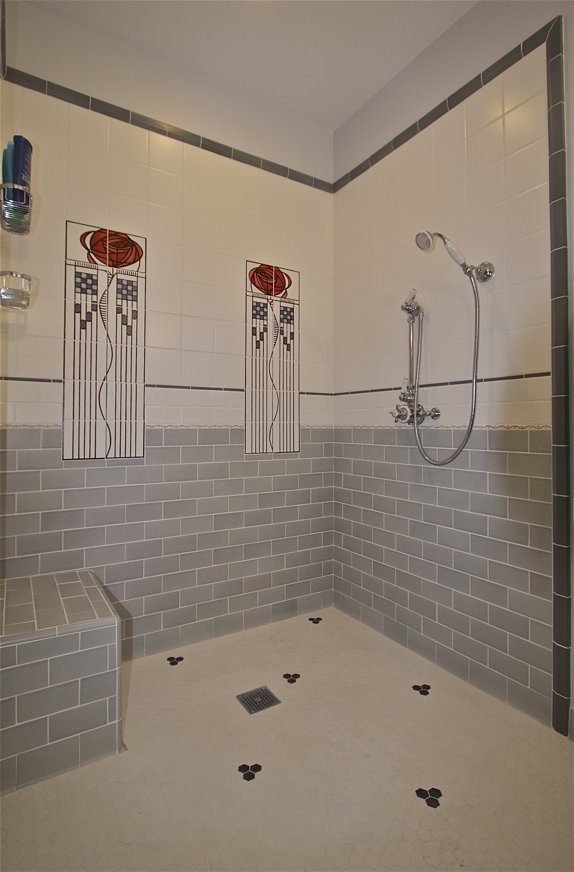 After: New damless shower incorporating 12 sq. ft. of areafrom adjoining half bath.