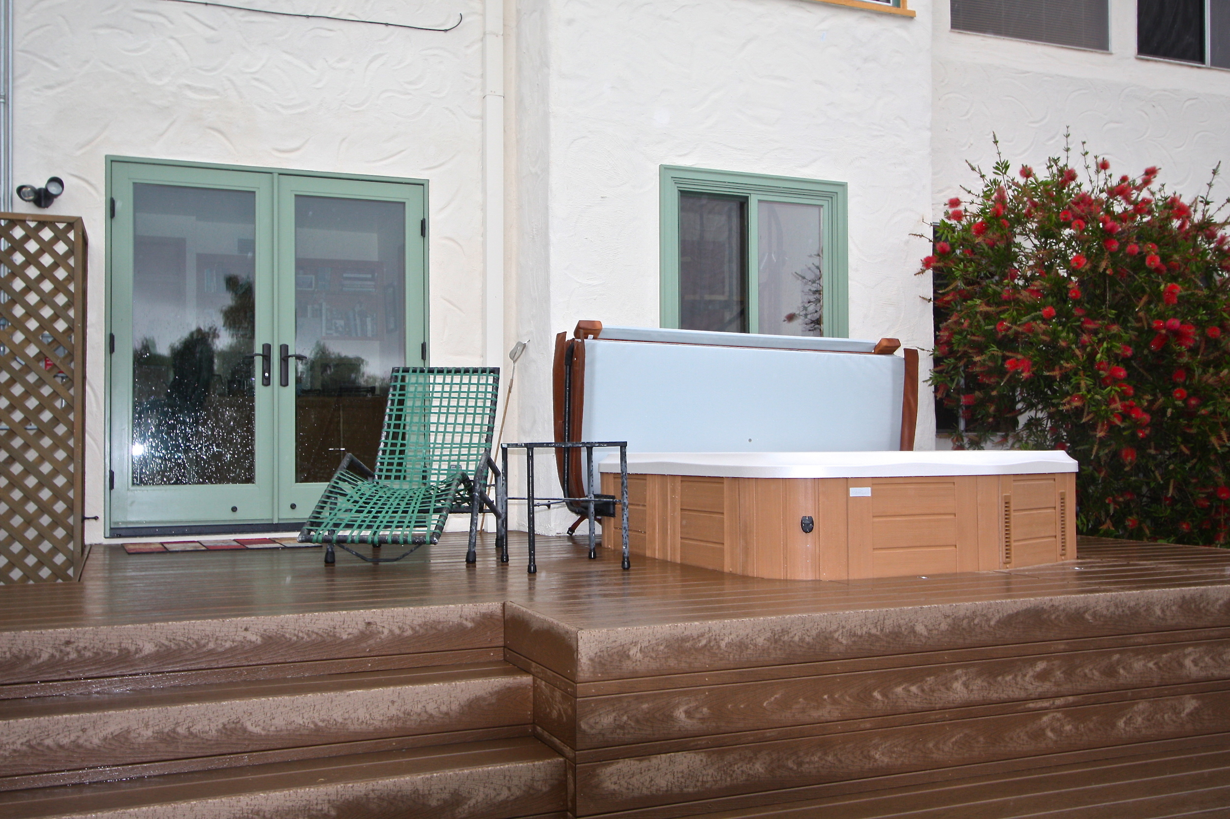 After: Multilevel deck and jacuzzi. Aluminum sliding door and window replaced with fiberglass french doorand window.