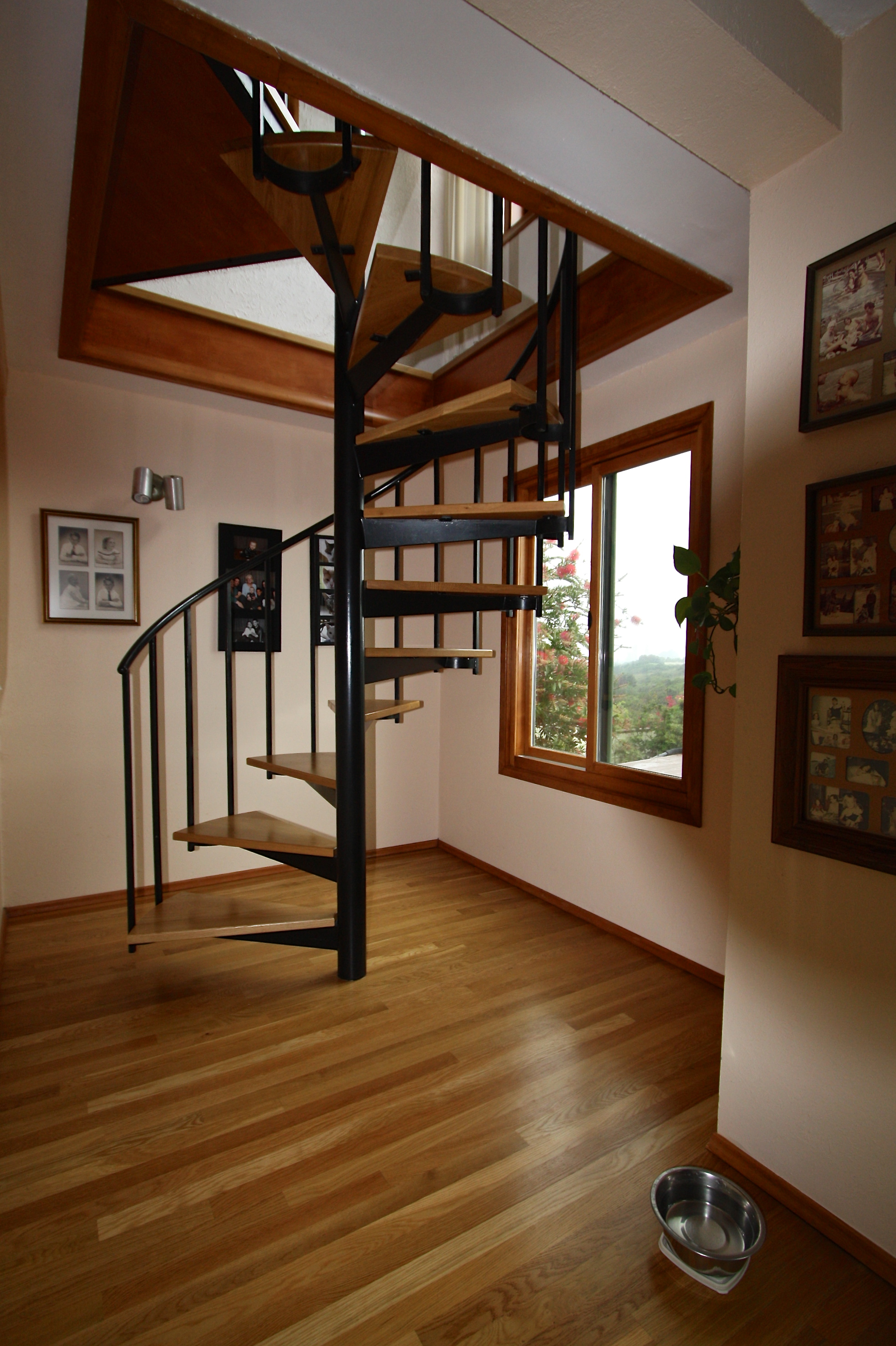 After: Oak floor and spiral stair treads.