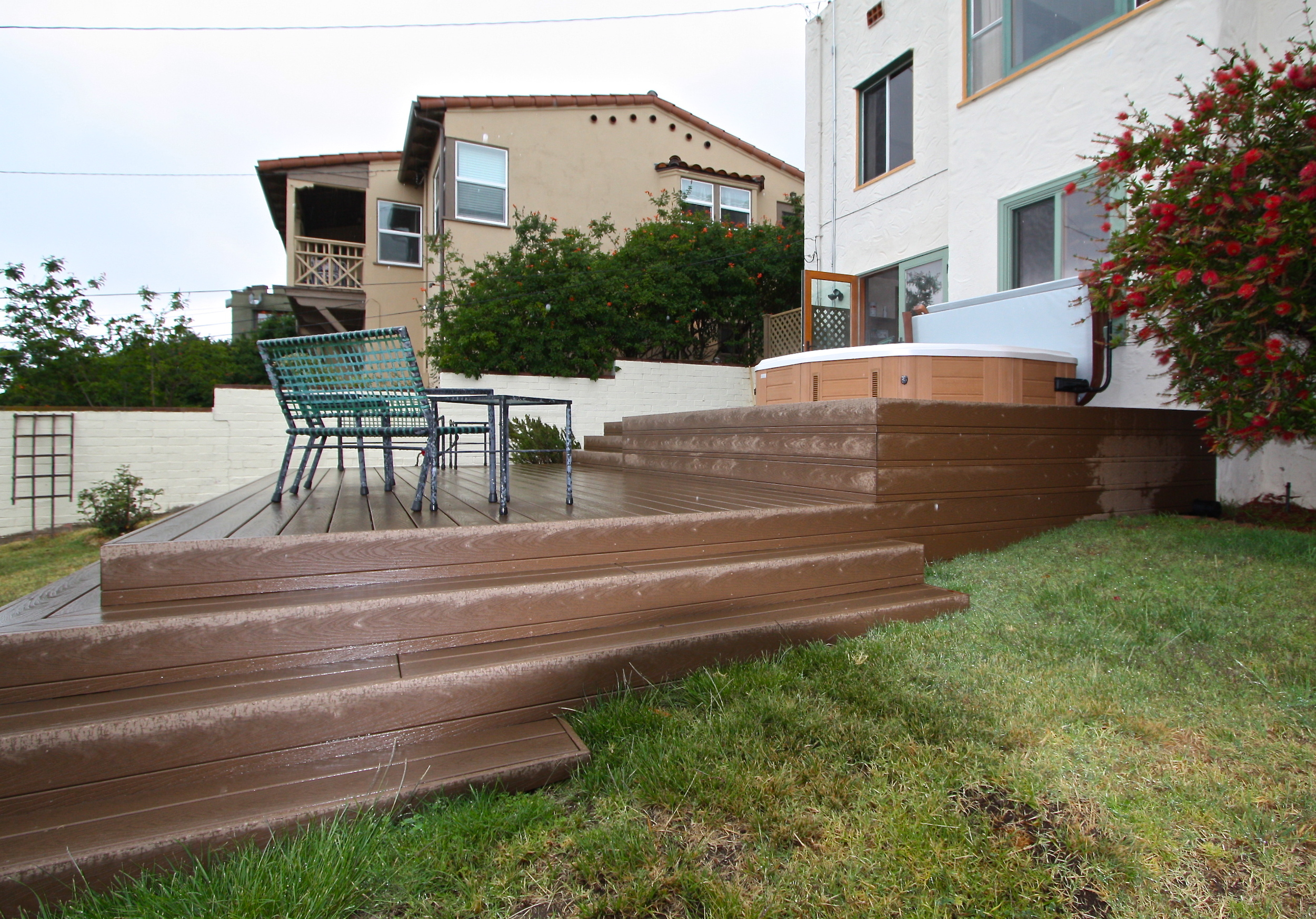 After: Deck follows contour of the yard, a lattice enclosure screenutilities from view.