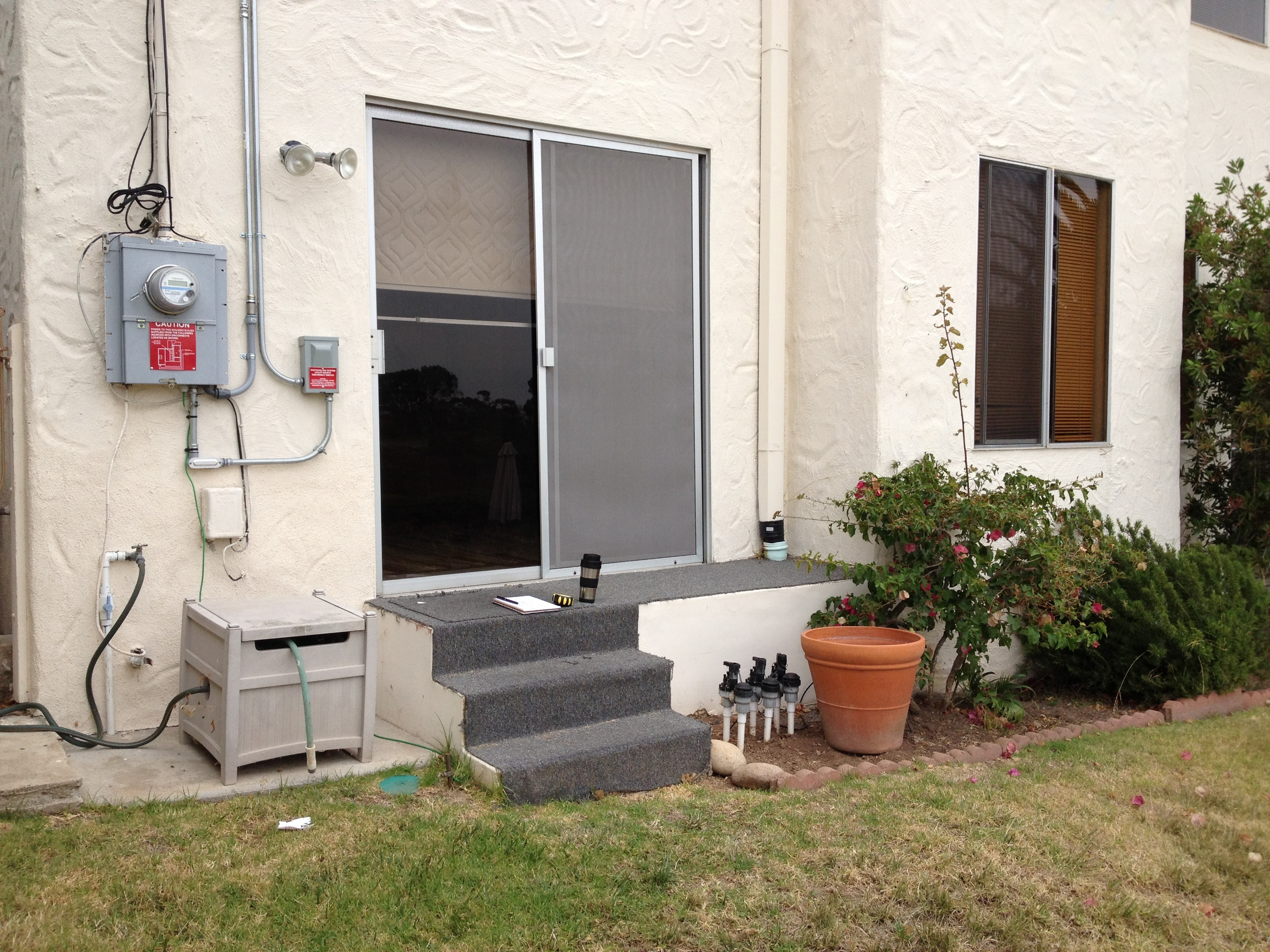 Before: Sliding door and steps to back yard.