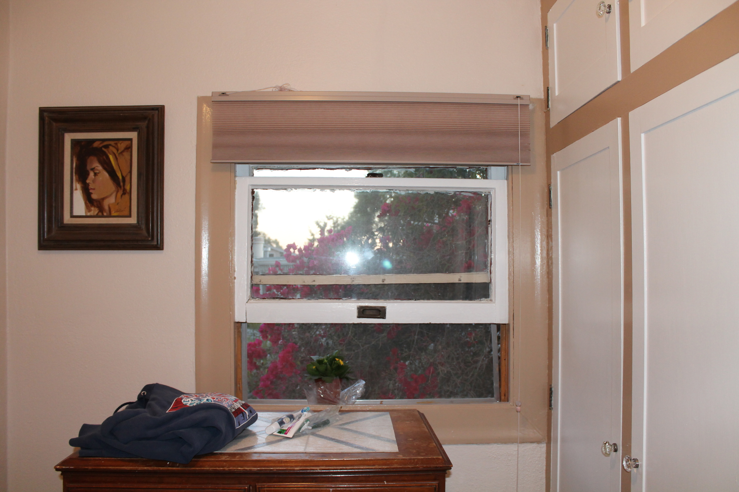 Before: Built in closet which was removed and the space was given to the other bath for a large shower.