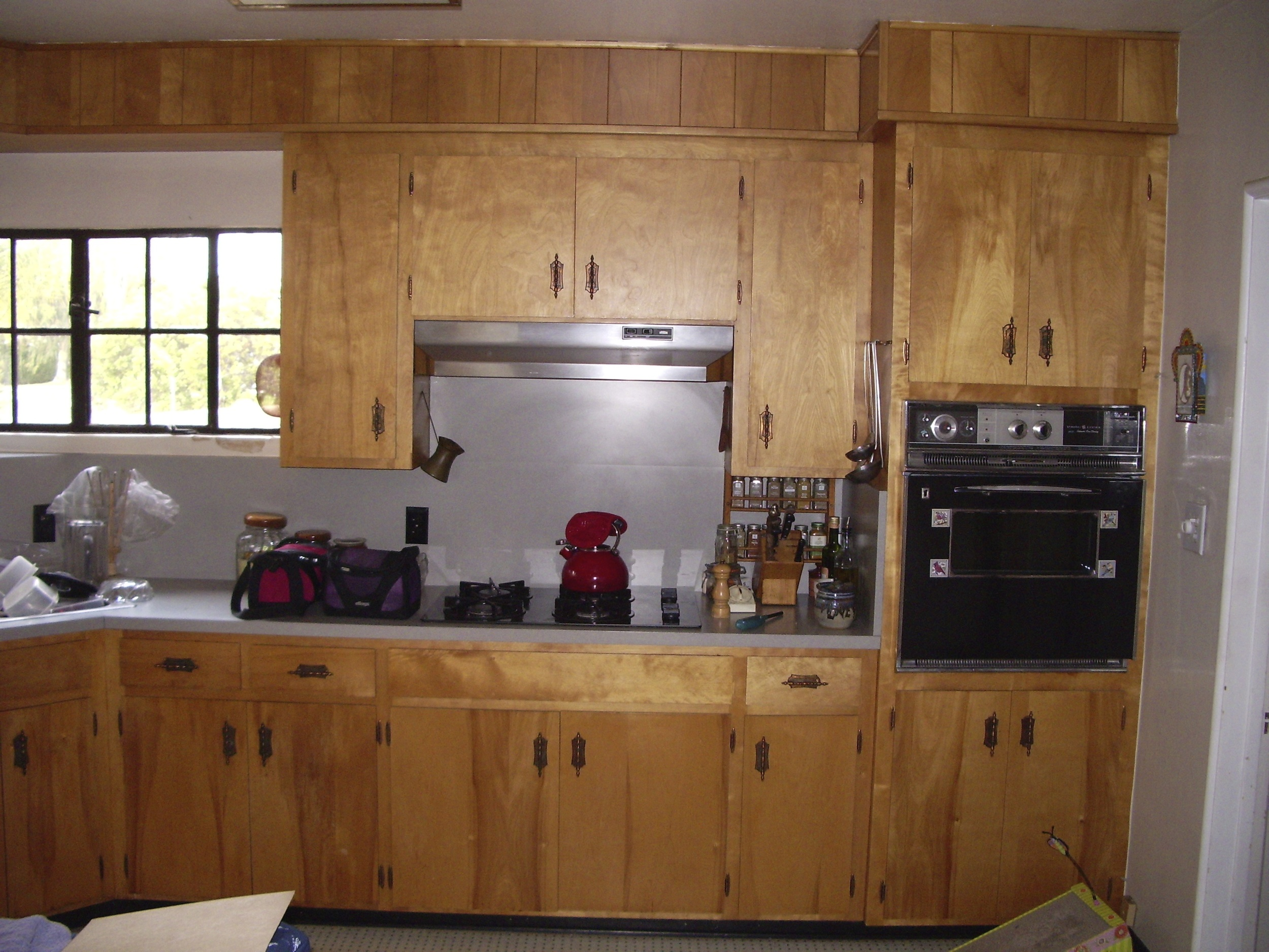 Before: Old site-built cabinets.