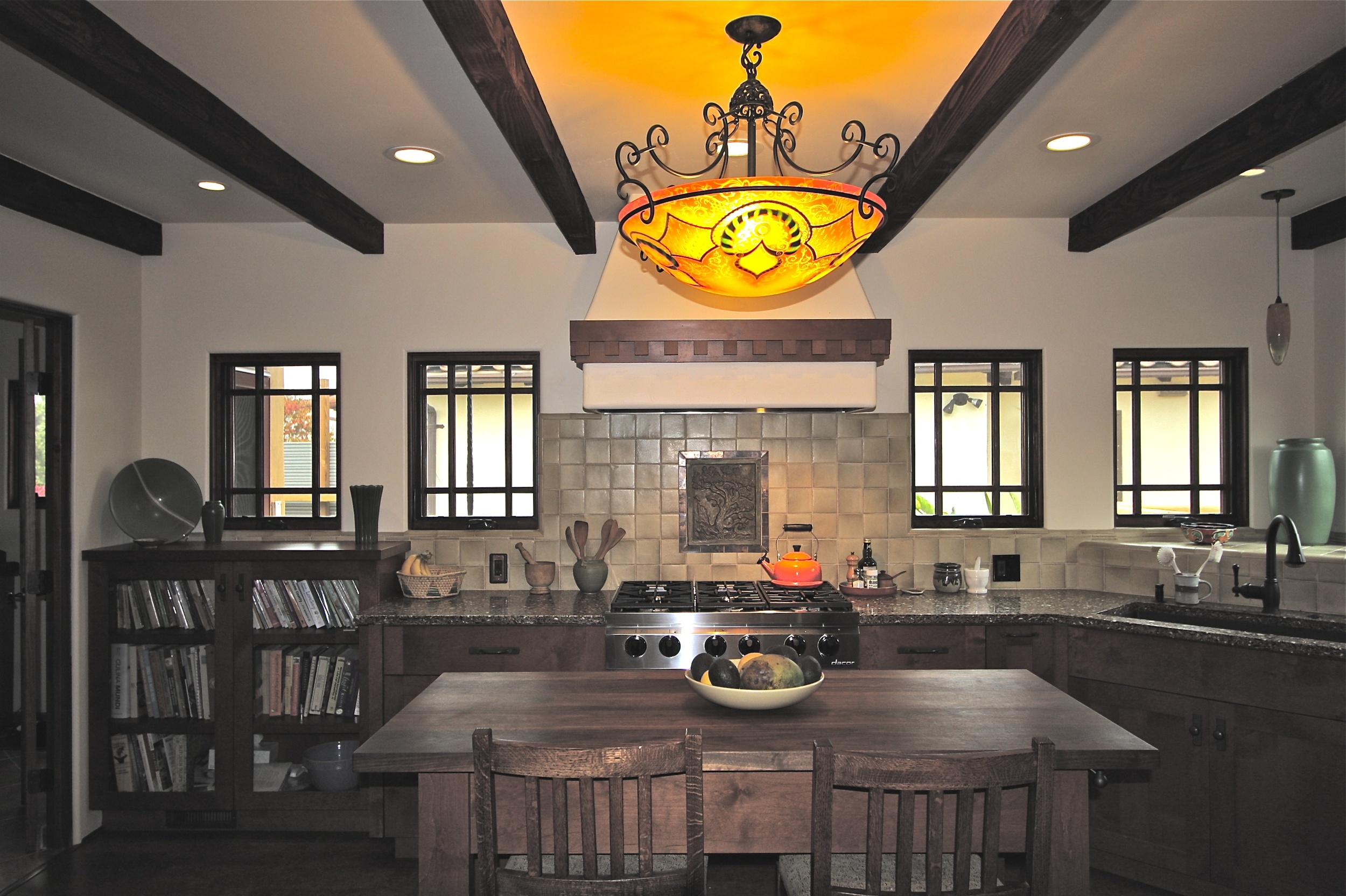 Island table and all custom cabinetry by Artistic Freedom Designs of Vista, CA.
