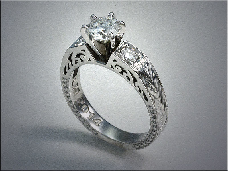 Diamond engagement rings with scrolls.