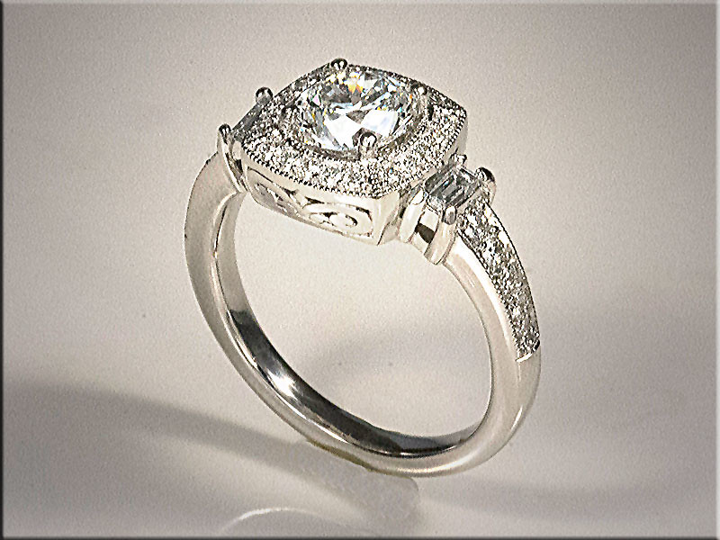 Diamond engagement ring with square cushion top.
