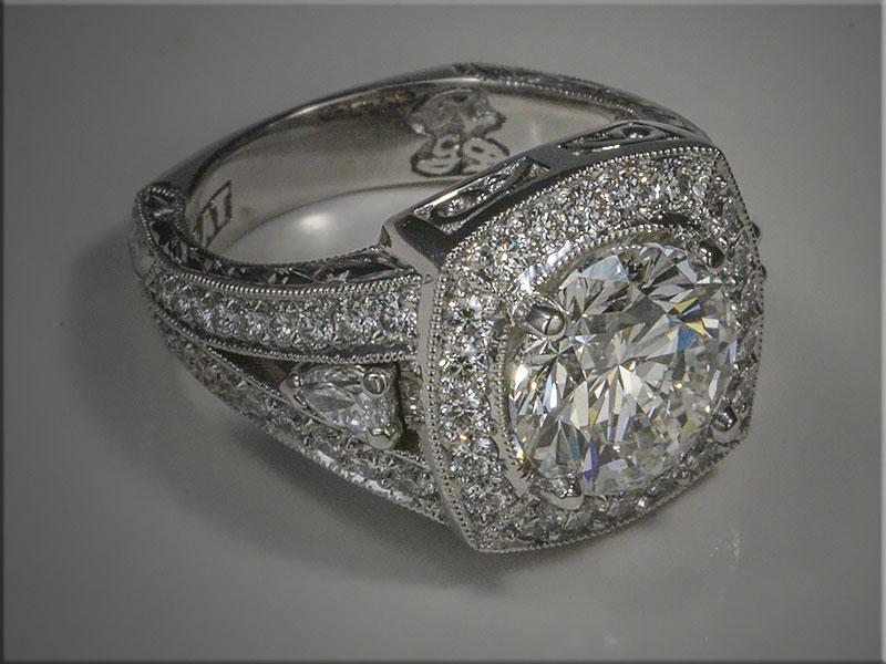 Diamond ring with 3 ct center diamond.