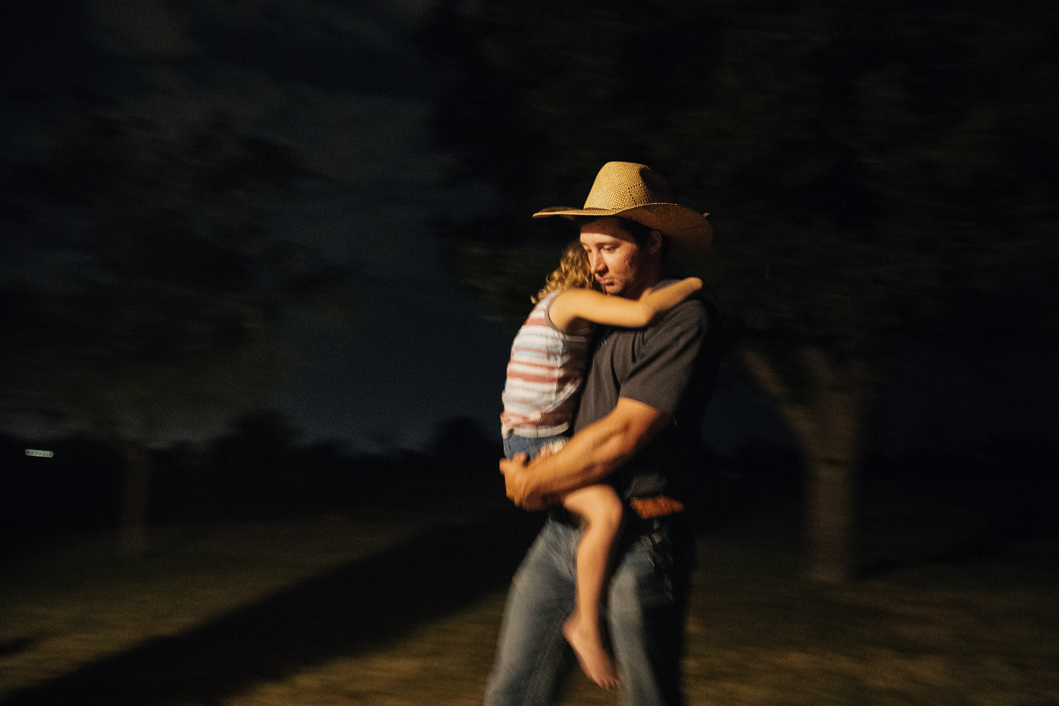 Hawkins carrying Shawn's daughter Paisley into the house after a long night.
