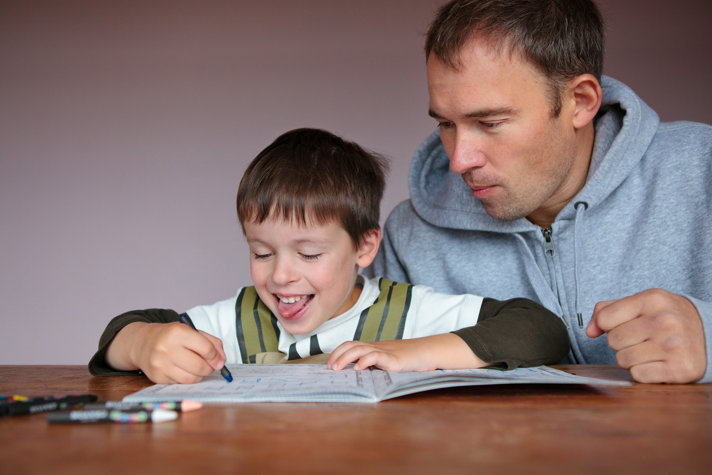 Fill Me In English Language Services, Parent Helps with Homework.jpg