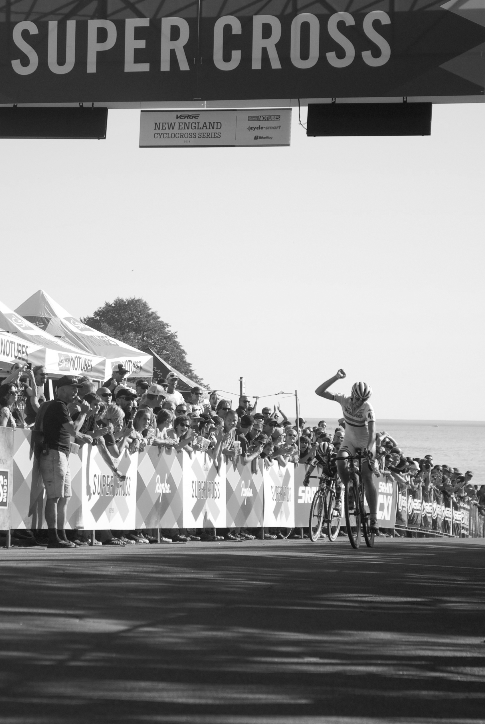 Helen Wyman celebrates her win as she crosses the finish line on Day 1 of the RSC UCI Pro Women's Race