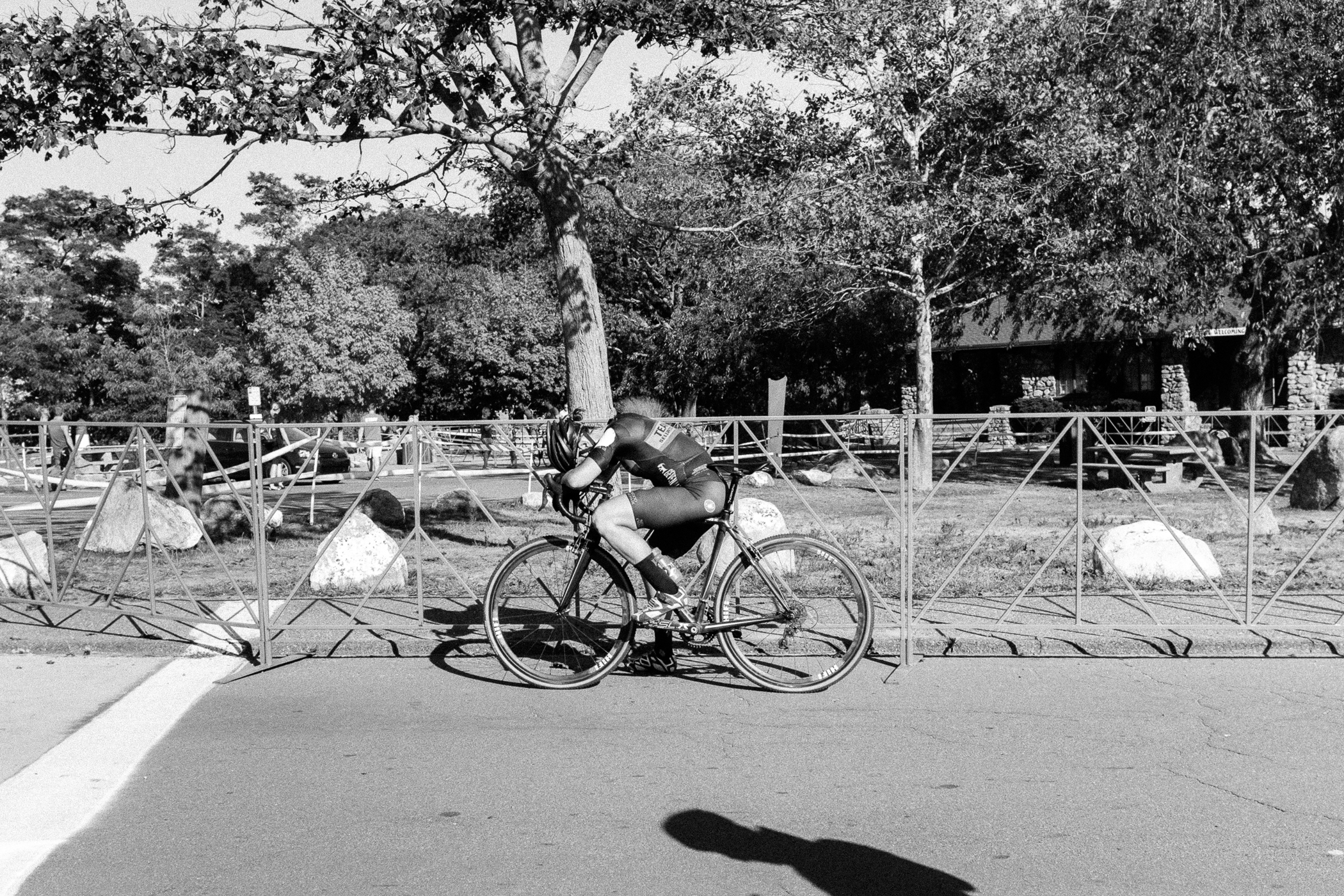 A finisher bows over, regaining her breath after racing at Providence Cyclocross Festival