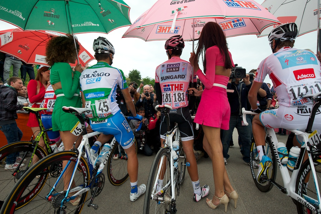 At the start of each stage of the Giro d'Italia, podium girls hold umbrellas over the competitors to protect them from the sun. Photo by Gregg Bleakney