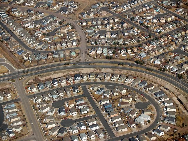 """Suburbia by David Shankbone"" by David Shankbone - David Shankbone. Licensed under CC BY-SA 3.0 via Wikimedia Commons"