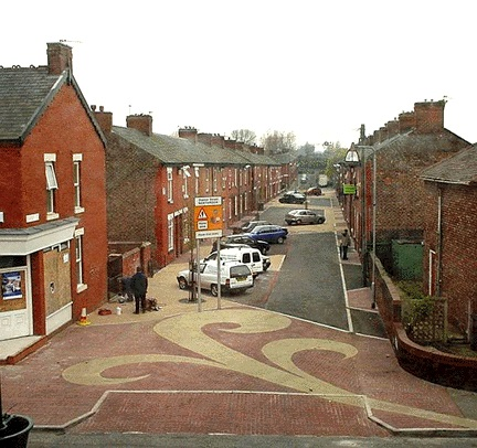 A shared space in Manchester, England. Many Americans also live on streets with no segregation (no sidewalks and bike lanes) - yet consider it inferior to this example. I guess urbanists want us to pave our streets in something other than asphalt before they will consider it a shared space.