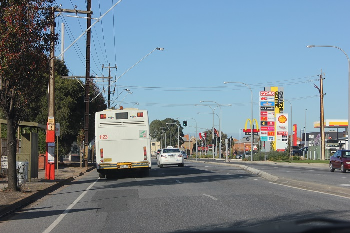 A commercial Complete Street with all of the elements in Kilburn, South Australia. The inhumaness of it being so open with nobody else walking around, along with very few things worth walking to within a reasonable distance, and high speed machinary flying past makes you feels incredibly out of place on foot.