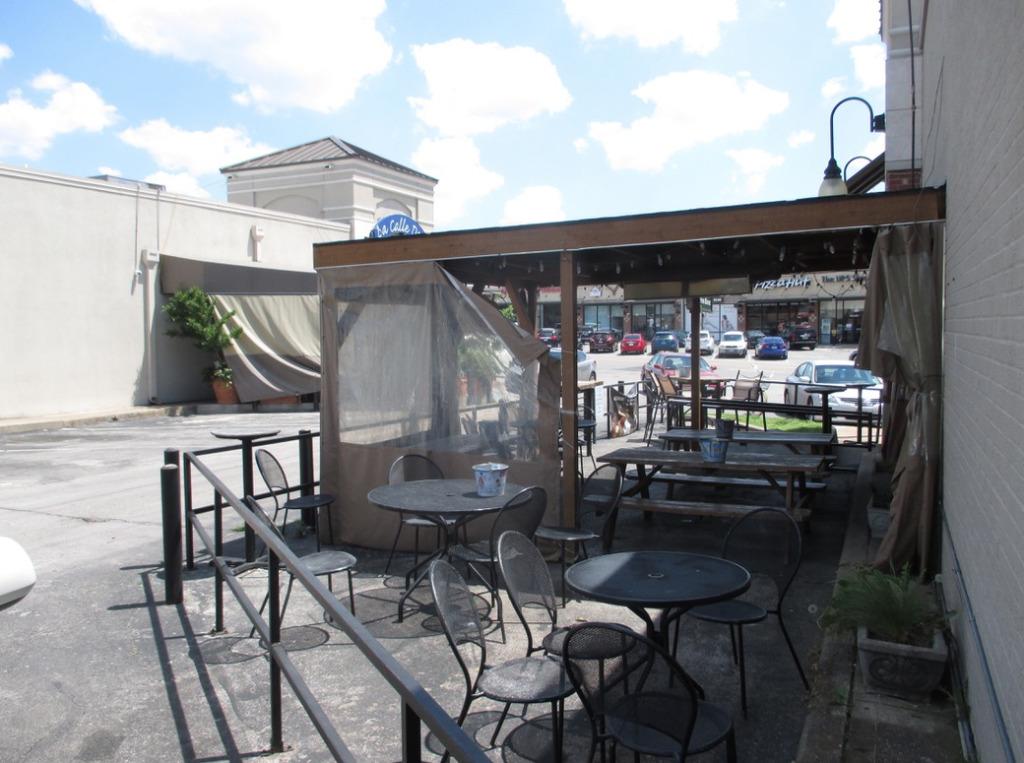 outdoor seating black rail.jpg