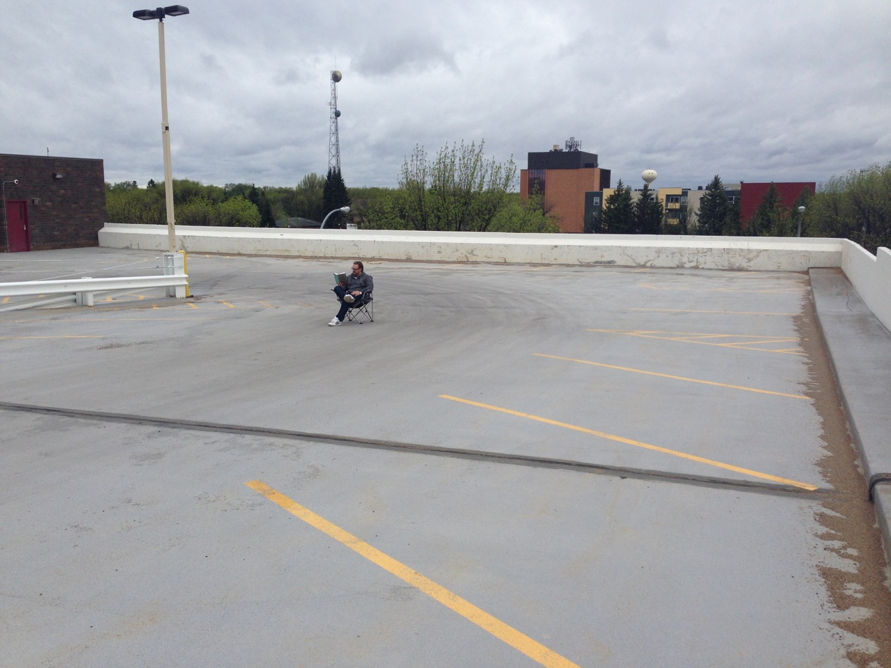 Strong Towns member Jonathan Holth enjoying an abundance of parking in downtown Grand Forks.