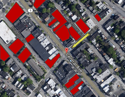 Red is available off-street parking. The yellow arrow identifies the travel direction of the garbage truck.