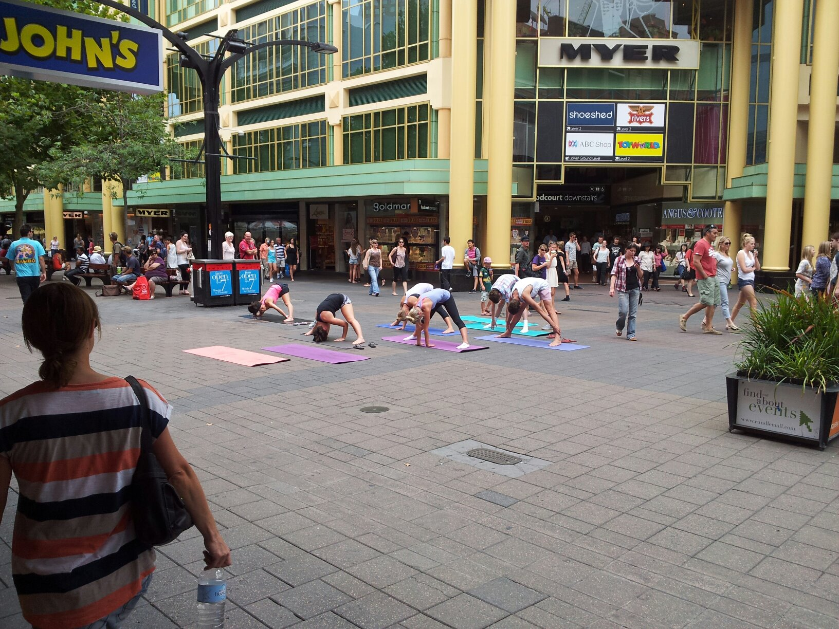 Street yoga out on a pedestrian mall in Adelaide.