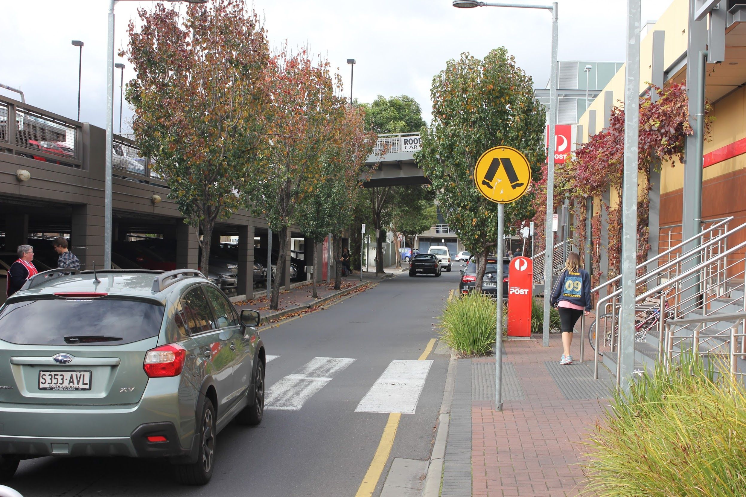 A one-way street in Adelaide with a crossing halfway up the block. A slightly better solution, but how often should we place the crossings? What if we wanted the entire street to be a crossing?