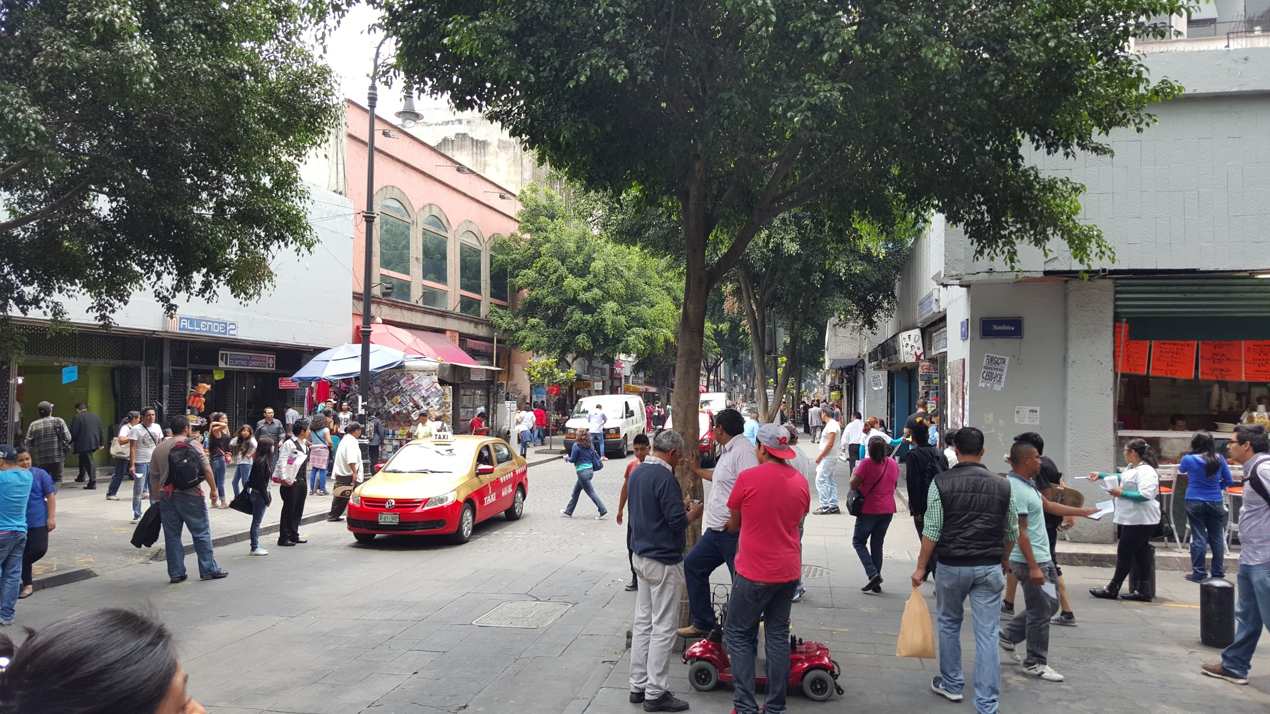 People jaywalking all over the place in this street in Mexico City. Why? Because it does not feel dangerous to walk in the middle of the street when everybody else is doing it.