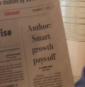 "Newspaper headline: ""Author: Smart growth pays off"""