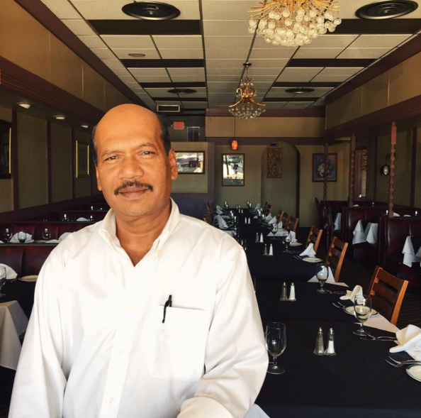 Ataur Rahman, owner of Himalayas Indian Restaurant, which has been around for 30 years and counting. Mr. Rahman immigrated to this country from Bangladesh.