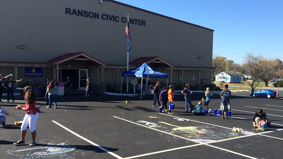 Children in Ranson making good use of an empty parking lot with chalk