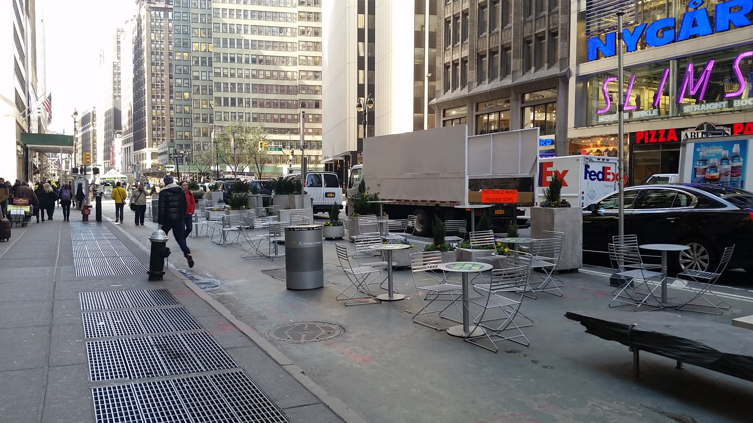 Reclaiming a portion of a street from automobiles in NYC.