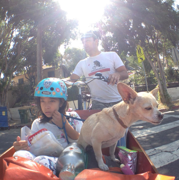 Joe, his daughter and their dog bike to school