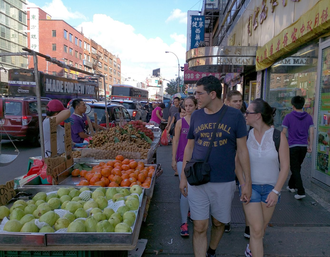 In New York City's Chinatown foods can be sold from the sidewalk. Note how the pedestrians' eyes are drawn to the produce.  (Photo by Alexander Dukes)