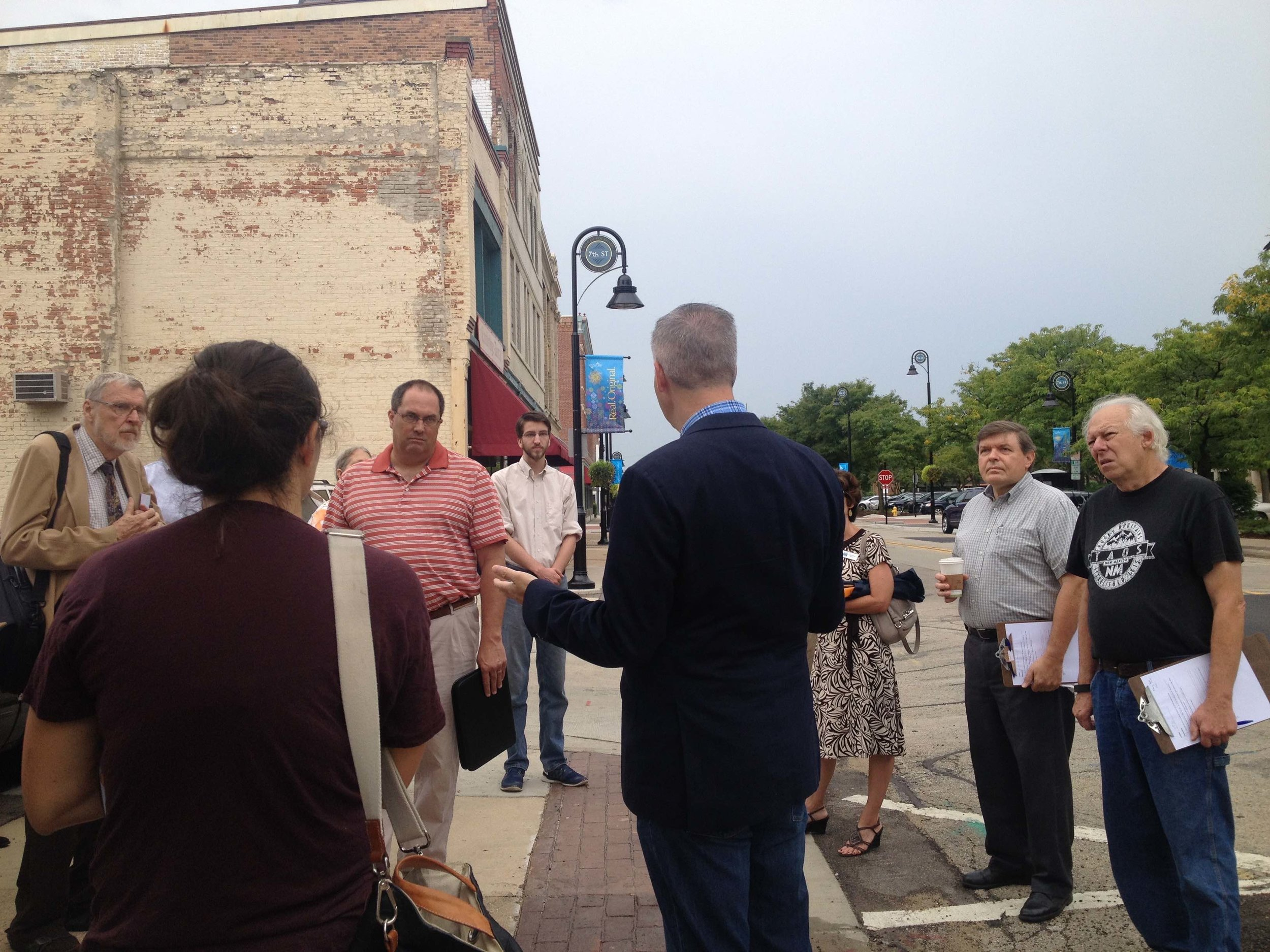 Chuck speaks during a walking tour in Rockford.