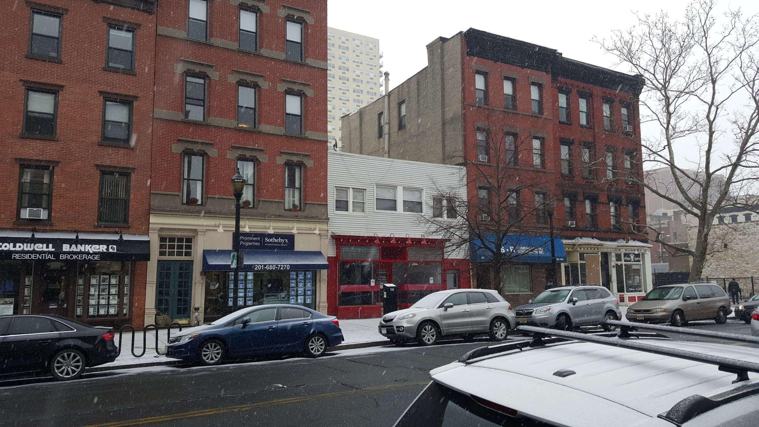 Cars lined up in front of stores in Hoboken, NJ. You can fit in perhaps one parking space per store. Ample room if treated as a loading bay, but certainly not enough to fill your business with visitors.