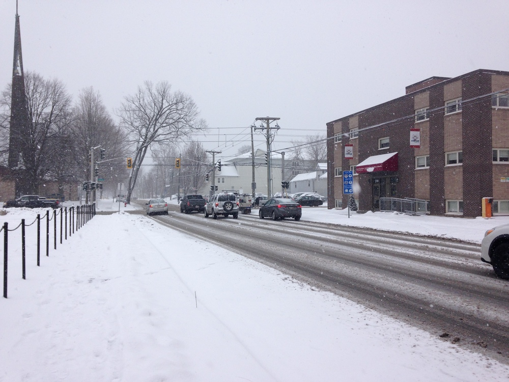 A three-lane segment of Brunswick Street right before the market. I took this picture during a snow storm power outage, which meant that this intersection became accidental shared space with no traffic-lights. Everyone slowed down, yielded to pedestrians, and no one was hurt