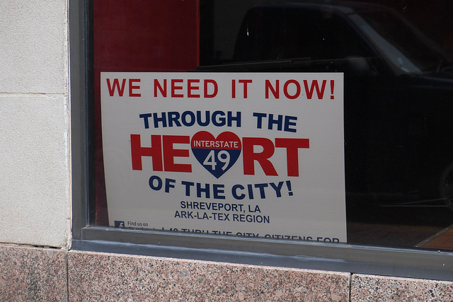 Voting against your interests? A pro-highway poster found in the window of a Shreveport business. (Photo by  Paul Sableman )
