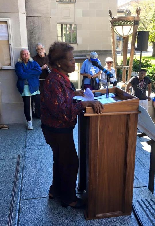 Rosie Chaffold with other community activists speaking at a rally in front of the Caddo Parish Courthouse (Image from  #AllendaleStrong facebook page )