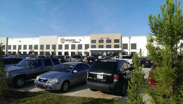 An Amazon fulfillment center and accompanying parking lot. Source: Lvi56