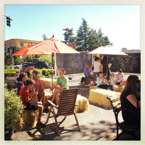 Residents of Sebastopol enjoy some share in a parklet on a hot day. (Source: Paul Fritz)