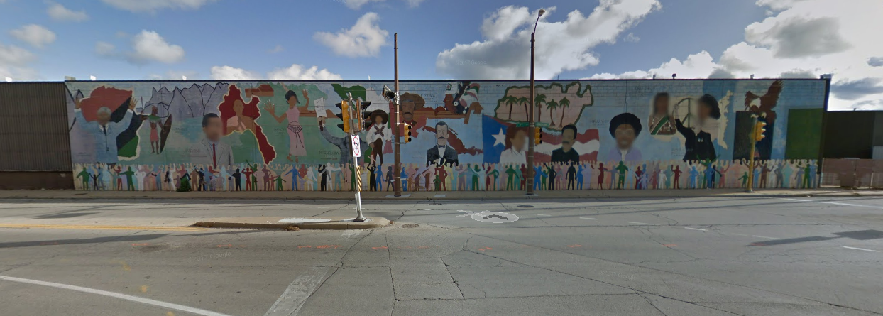 Image from Google Earth (which has hilariously blurred the faces of every person featured in the mural)