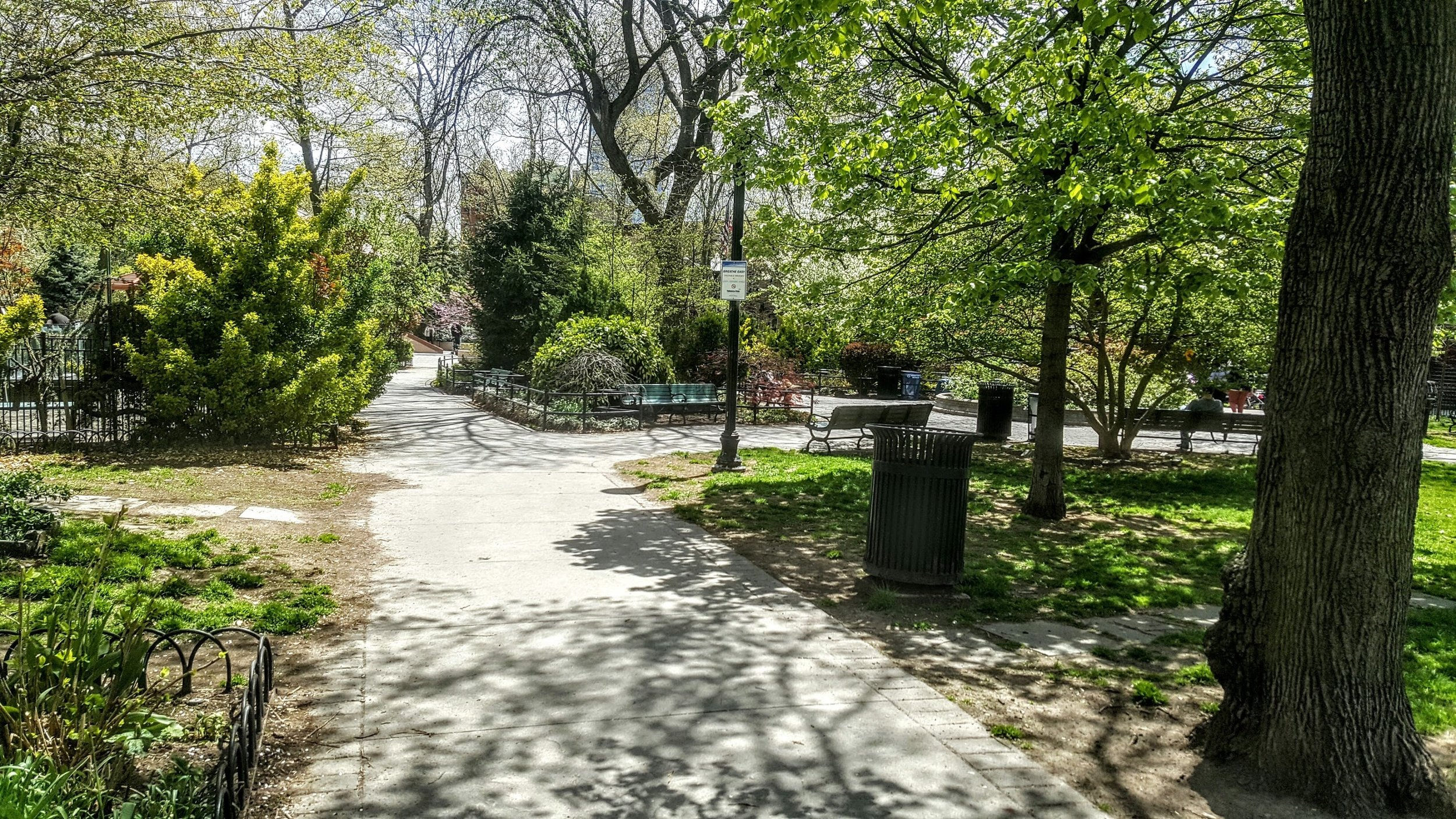 A path that weaves around benches and trees as it takes you between the various outdoor rooms of the park.