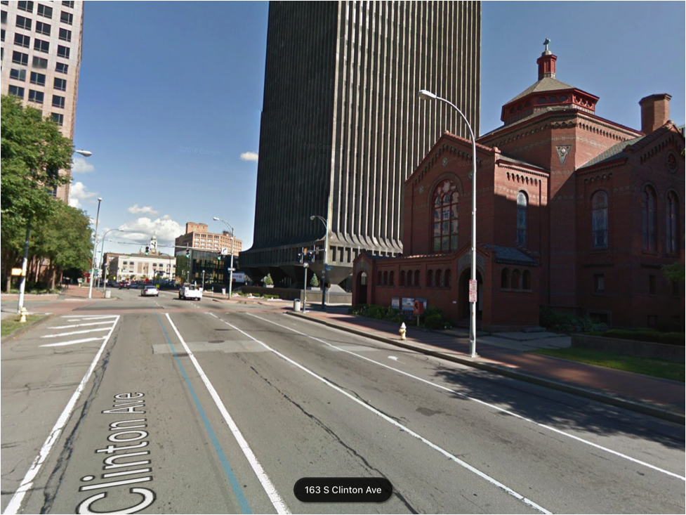 Surrounded by fortress-like office structures, a historic church is now alone in its effort to welcome people off of the streets with large accessible entrances opening right onto the street. The street has been widened to a whopping 5 lanes, including the shoulder. (Image from Google Earth)