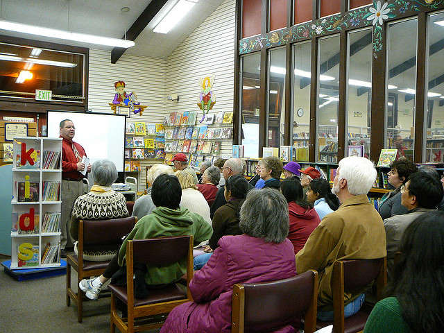 A community meeting in a library (Source:  San Jose Public Library )