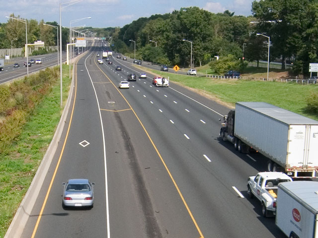 A high occupancy vehicle lane is pictured on the left side of this road.
