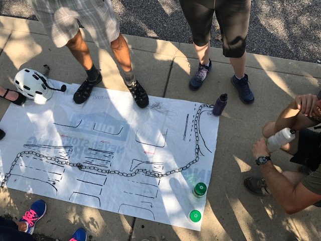 The Cycling Savvy class discusses how to map a safe route through a busy intersection.