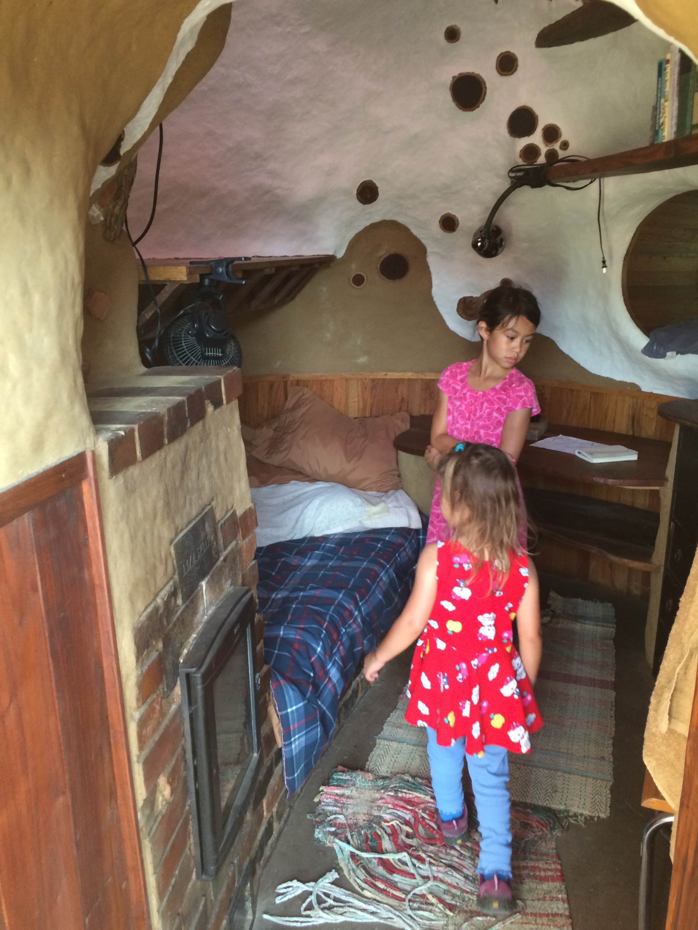DR kids show off an accessory dwelling unit bedroom that is rented out to visitors. (Source: Kea Wilson)