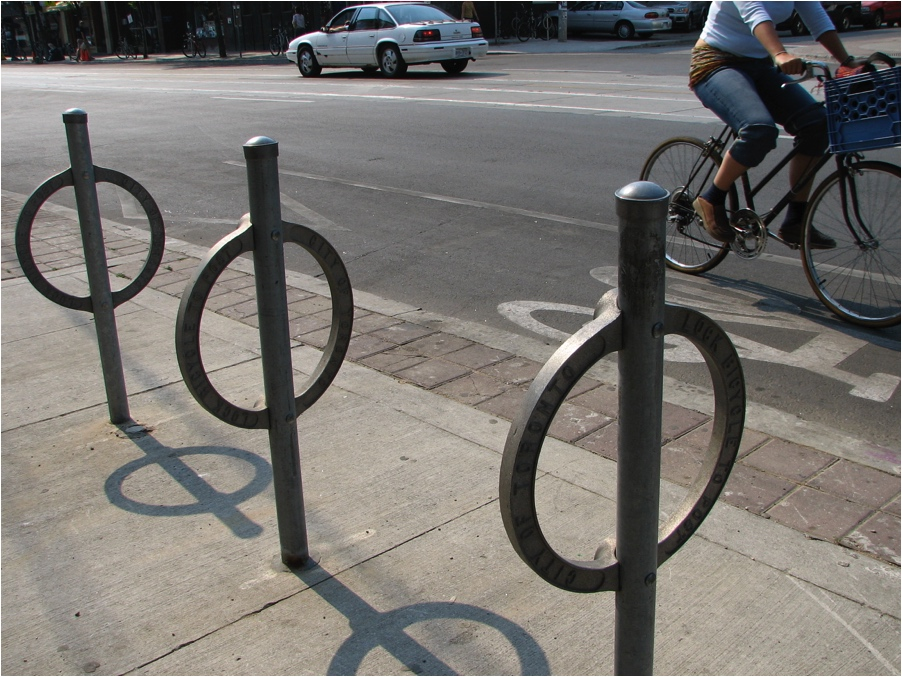 Simple and cheap. Each holds two bicycles. (Source:Wikimedia Commons)