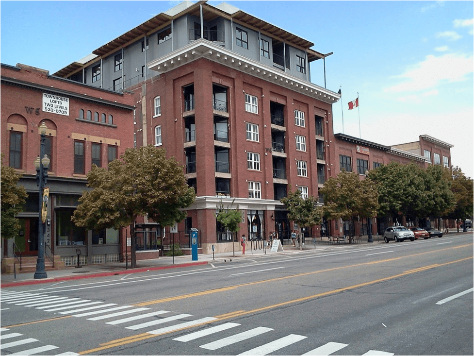 """Downtown Street - Fewer pedestrian amenities than Main Street, but still a """"people first"""" street with slow traffic. Buildings are often 3+ stories."""